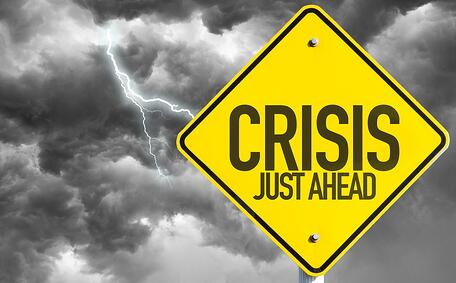 Crisis Just Ahead sign with a bad day.jpeg